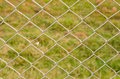 Wire mesh fence close up on green background Royalty Free Stock Photography