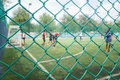 Wire mesh fence from football field with competitive in the public areas. Royalty Free Stock Photo