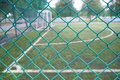 Wire mesh fence in soccer field. Royalty Free Stock Photo