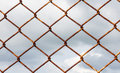 Wire mesh fence on storm clouds background Royalty Free Stock Photography