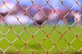 Wire mesh and green nature landscape in background Royalty Free Stock Photography