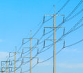 Wire pole at high voltage electrical post row of Royalty Free Stock Images