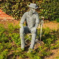 A wire sculpture entitled the gardener by derek kinzett situated in the rose garden at newstead abbey nottinghamshire united Royalty Free Stock Photos