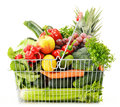 Wire shopping basket with groceries on white background Stock Photography