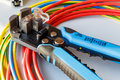 Wire stripper and cutter with colored wires Royalty Free Stock Photo