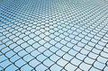Wired fence pattern of and blue sky Royalty Free Stock Image