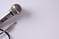 Wired microphone with connector on white table closeup top view Royalty Free Stock Photo