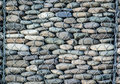 Wired stone texture cobblestone wall cube cobble rock rubble paving pebble Royalty Free Stock Image