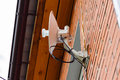 Wireless internet receiver antenna on a brick wall at home Royalty Free Stock Photo
