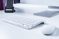Wireless keybord and mouse on a desk close up picture of keyborad in modern office Royalty Free Stock Photos