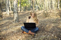 Wireless in nature a modern young woman outside a forest glade having fun using a laptop computer Royalty Free Stock Photos