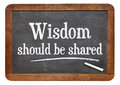 Wisdom should be share on blackboard inspirational text in white chalk a vintage slate Royalty Free Stock Photo