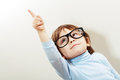 Wise little boy in glasses pointing outside the picture Stock Photos