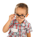 Wise little boy looking through big glassess Royalty Free Stock Photo