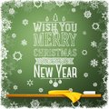 Wish you merry christmas and a happy new year message written on the school chalkboard like greeting for school Stock Image