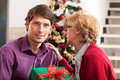 Wishes and christmas present from mother to son Stock Photo