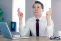 Wishing businessman crossing his fingers Royalty Free Stock Photo