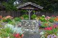 Wishing well in dahlia garden Royalty Free Stock Photo