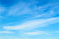 Wispy clouds against a beautiful blue sky during the height of summer Stock Images