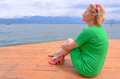 Wistful woman barefoot looking at the lake Stock Image