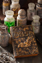 Witch apothecary jars magic potions book halloween decoration Royalty Free Stock Photo