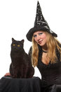 A witch with a black cat young woman in costume Stock Photos