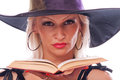 Witch with book close up shot of beautiful blonde hat holding and reading the isolated on white Stock Photo