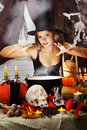 Witch brews a brew beautiful the potion in the boiler Stock Photos