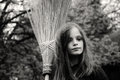Witch with broom portrait of a llittle Stock Photos