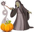 Witch casts a spell over pumpkin Royalty Free Stock Photo