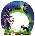 Witch and cat on a cemetery wicked with lantern black night halloween background Stock Photo