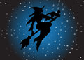 Witch the and cat silhouette flying on the sky Royalty Free Stock Image