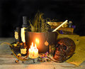 Witch cauldron halloween still life of old books burning candles skull and magic objects on wooden table Royalty Free Stock Photography