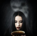 Witch with a cup of potion Royalty Free Stock Photo