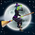 Witch flying in front of the moon a cartoon halloween character a big full Stock Image