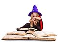 Witch girl holding book little stack Stock Photos