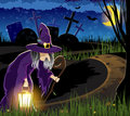 Witch goes to the cemetery with a lantern on path leading old halloween night scene Stock Image