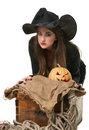 Witch in a hat sitting near the chest Royalty Free Stock Photo