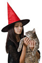 A witch and her cat teenager with hat Royalty Free Stock Images