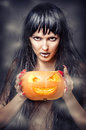 Witch holding pumpkin Royalty Free Stock Photos