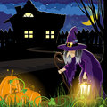 Witch near the house old and pumpkins with glowing windows halloween night scene Royalty Free Stock Photos