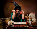Witch with poison apple Stock Images
