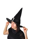 Witch portrait of a teenager girl with a hat Royalty Free Stock Photos