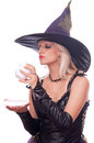 Witch predicts the future blonde holding and looking in coffee cup and telling about Royalty Free Stock Photography