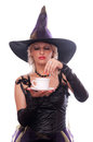 Witch put magic powder in the coffee blonde costume cup of isolated on white Stock Photos
