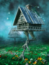 Witch's cottage on a meadow Royalty Free Stock Photo