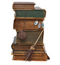Witch s library stack of old book with funny small broomstick and medallion isolated Royalty Free Stock Images