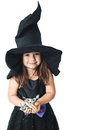 Witch shows the collected candy little Stock Photo