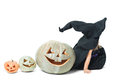 Witch sits in line with pumpkins Royalty Free Stock Photo