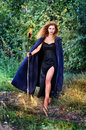 Witch with with torches Royalty Free Stock Photo